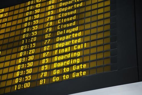 Low Angle View Of Arrival And Departure Information At An Airport. Horizontal Shot.